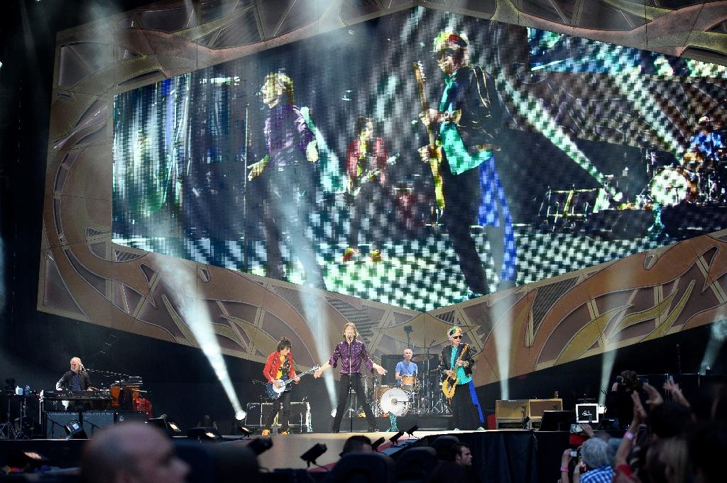 Members of the Rolling Stones perform during a concert at the Stade de France in Saint-Denis on June 14, 2014