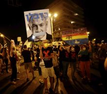 Thousands protest Netanyahu; many ignore Israeli virus rules