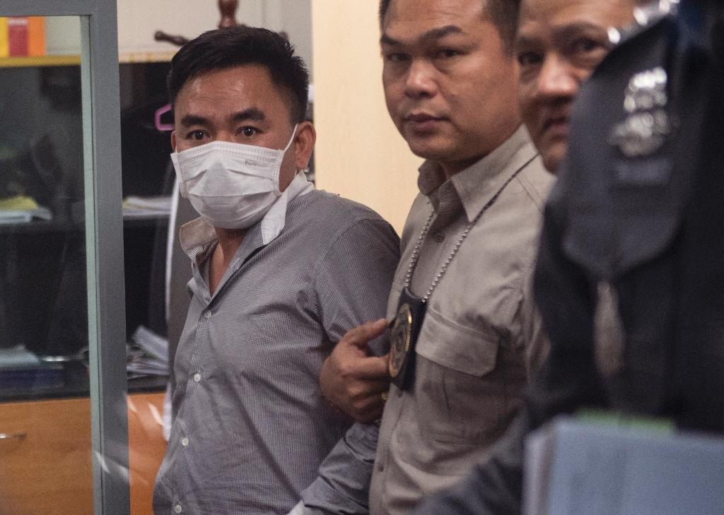 Boonchai Bach (L) is the alleged ringleader in a major syndicate trafficking in parts from endangered species used in Vietnamese and Chinese traditional medicine (AFP Photo/Roberto SCHMIDT)