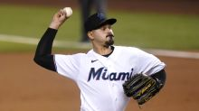 López escapes jam to help Marlins beat Arizona 3-1 for sweep