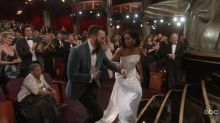 Chris Evans chivalrously helped Regina King onstage at the Oscars