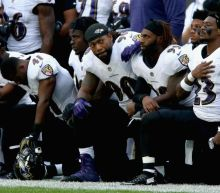 Take a knee: Dozens of NFL players stage biggest protest yet in response to Donald Trump comments