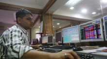 Sensex, Nifty hit record closing highs; Reliance Communications falls
