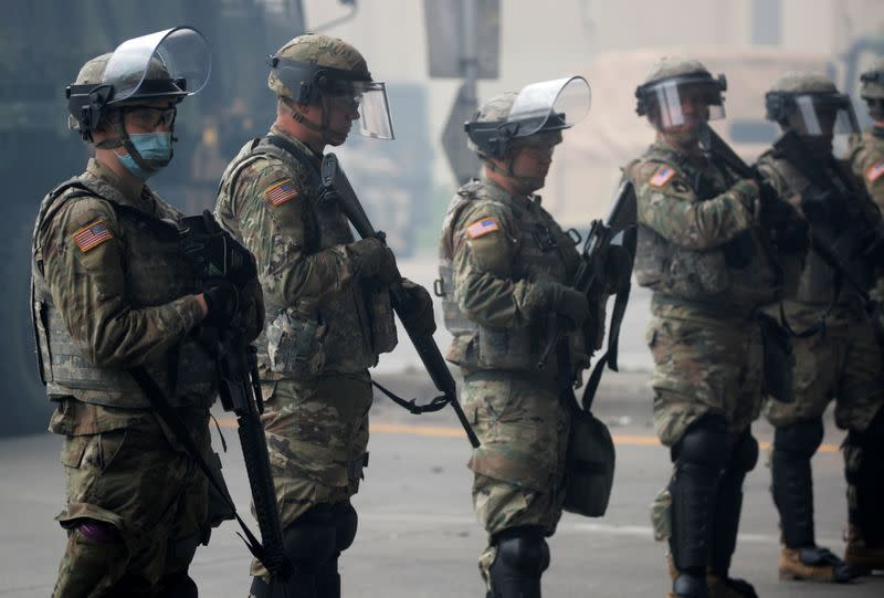 National Guard members guard the area in the aftermath of a protest, in Minneapolis
