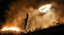 Israel launches airstrikes on Gaza after Palestinians send incendiary balloons