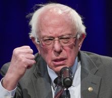 The Latest: Leahy backs Sanders in shift from 2016