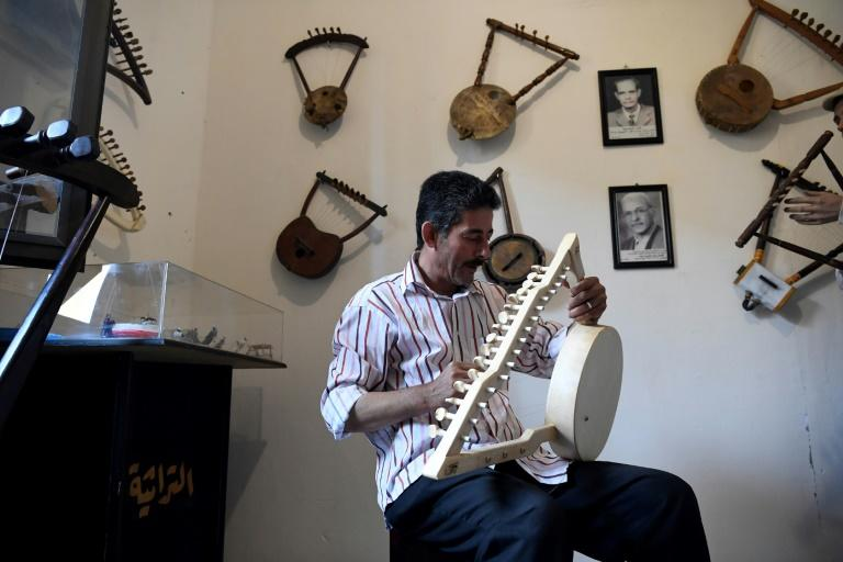 Egyptian craftsman                                                  Mohamed Ghaly adds the                                                  finishing touches on a                                                  semsemia that he made at                                                  the Canal 20 cultural                                                  museum in Port Said                                                  which he founded to pass                                                  on the musical heritage                                                  to a new generation (AFP                                                  Photo/Khaled DESOUKI)