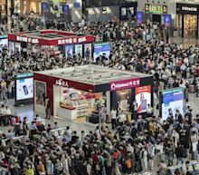Chinese rail stations and airports swamped during holiday, raising fears of fresh Covid outbreak