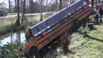 Louisiana school bus hits a house with students on board