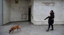 Greek parliament approves more bailout reforms despite protests