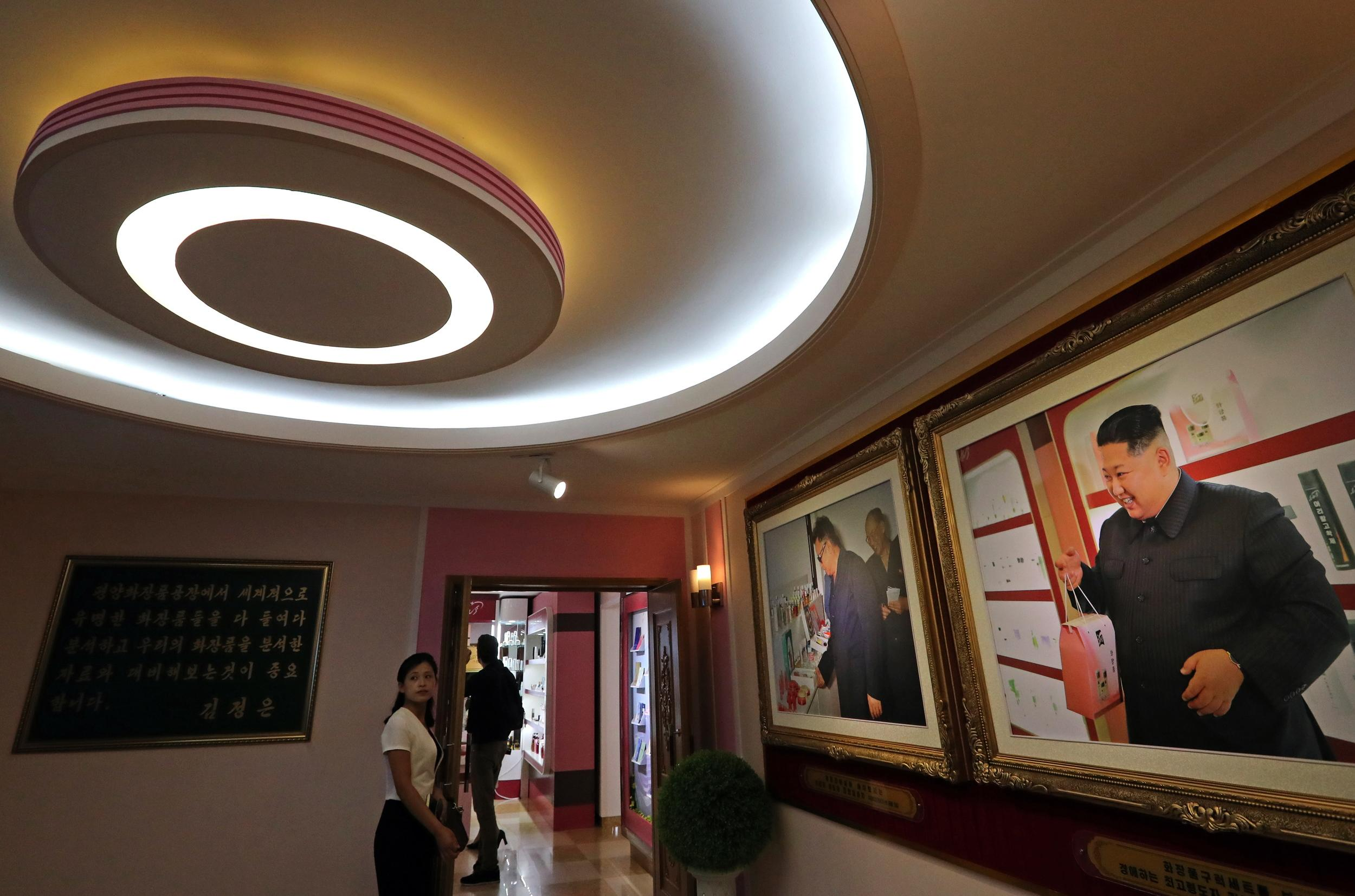 PYONGYANG, NORTH KOREA - SEPTEMBER 7, 2018: A photograph of North Korea's Supreme Leader Kim Jong-un on display at the entrance to a cosmetics factory in Pyongyang. Alexander Demianchuk/TASS (Photo by Alexander Demianchuk\TASS via Getty Images)