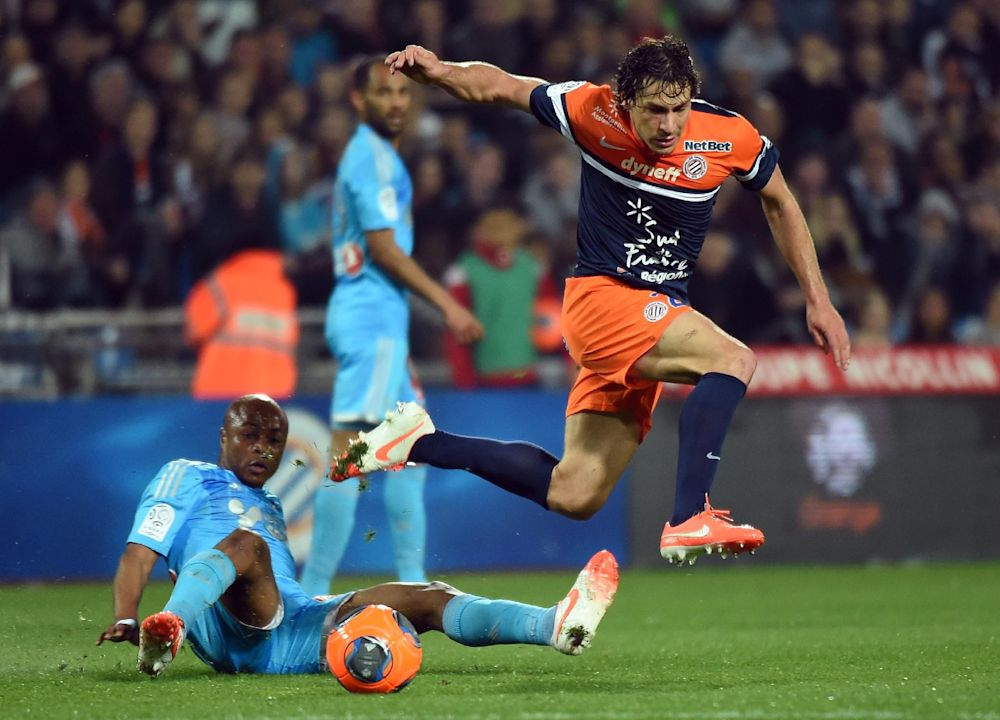 Montpellier's French defender Benjamin Stambouli (R) during the French L1 football match Montpellier vs Marseille, on April 11, 2014 at the Mosson stadium in Montpellier