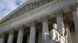 U.S. Supreme Court returns to work with glaring vacancy