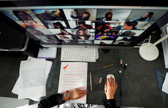 A student takes classes online with his companions using the Zoom app at home during the coronavirus disease (COVID-19) outbreak in El Masnou, north of Barcelona, Spain April 2, 2020. REUTERS/ Albert Gea     TPX IMAGES OF THE DAY