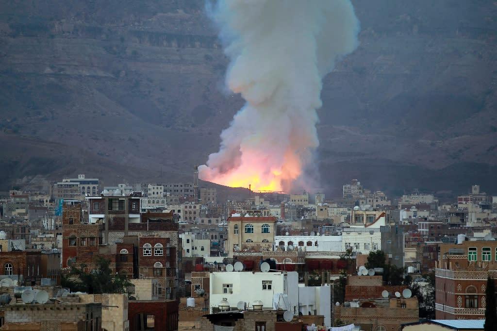 Smoke billows following an air-strike by Saudi-led coalition on May 11, 2015, in the capital Sanaa, Yemen