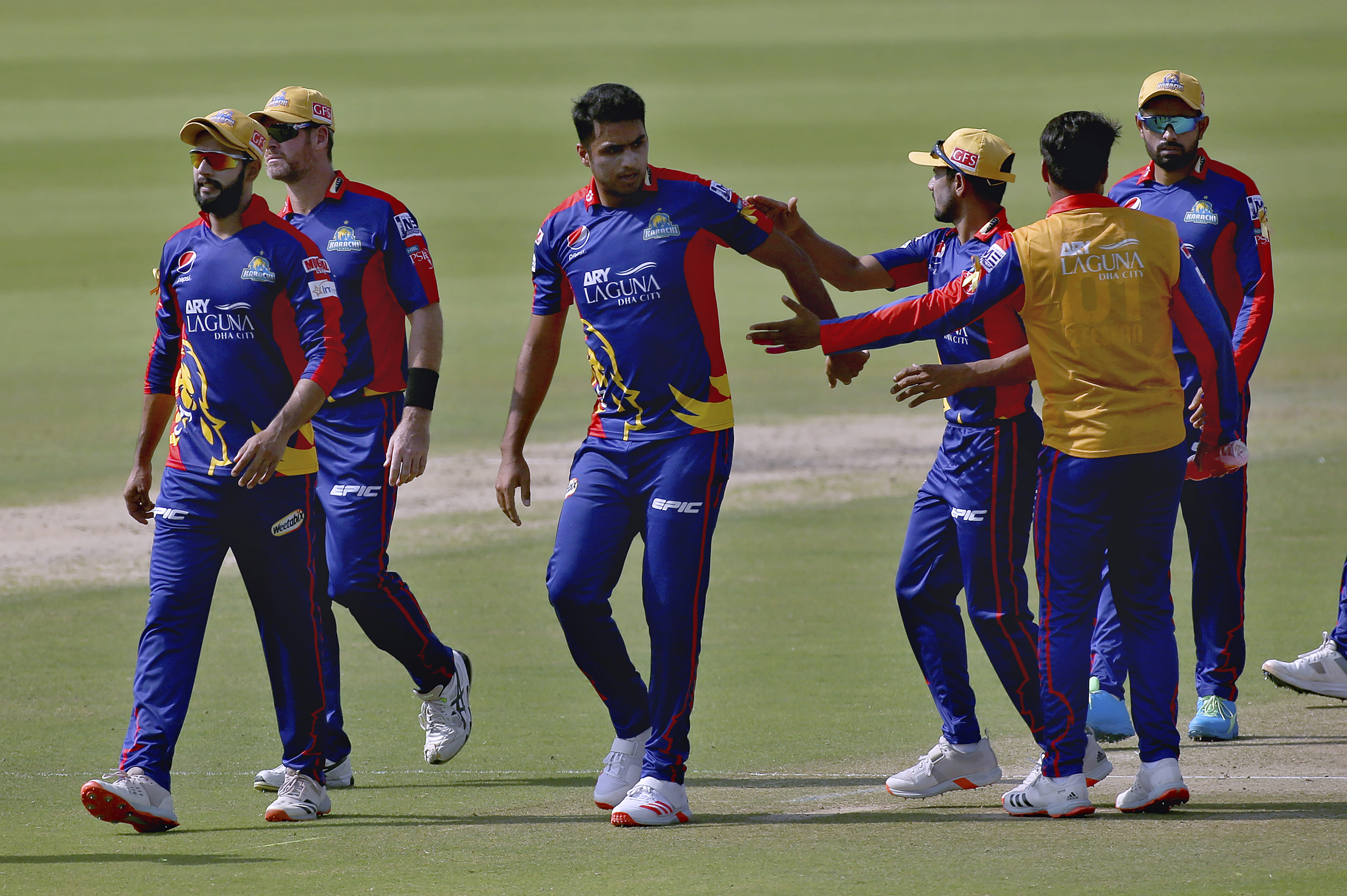 Karachi Kings' Arshad Iqbal, center, celebrates with teammates after taking the wicket of Multan Sultans' James Vince during a Pakistan Super League T20 cricket match between Karachi Kings and Multan Sultans at the National Stadium, in Karachi, Pakistan, Saturday, Feb. 27, 2021. (AP Photo/Fareed Khan)