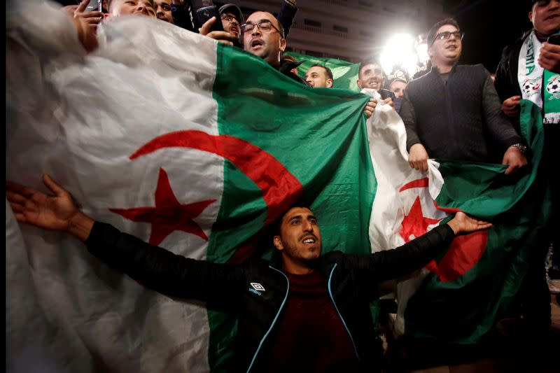 FILE PHOTO: People celebrate on the streets after Algeria's President Abdelaziz Bouteflika has submitted his resignation, in Algiers