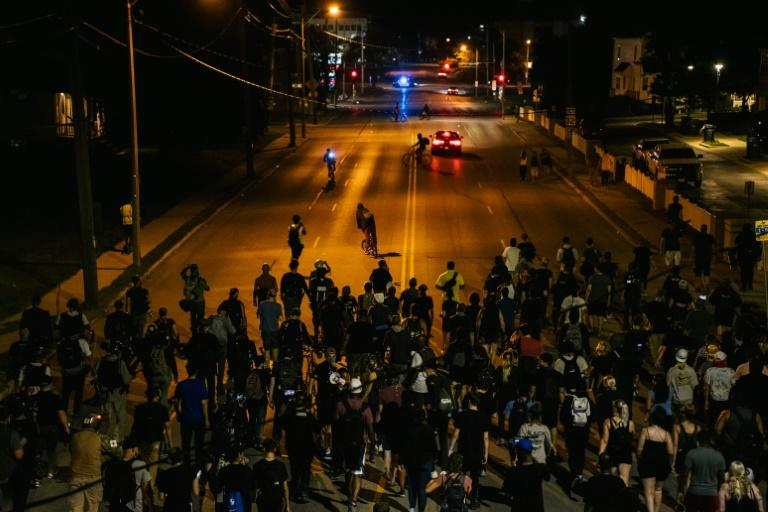 Demonstrators march in the streets of Kenosha, Wisconsin for a fourth night