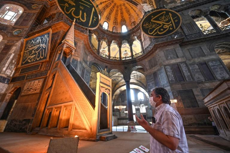 The sixth-century edifice -- a magnet for tourists worldwide with its stunning architecture -- had been a museum since 1935, open to believers of all faiths (AFP Photo/Ozan KOSE)