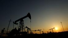 Oil settles slightly higher but posts weekly decline