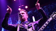 Rocker Josh Homme Apologizes For Kicking Photographer: 'I Was A Total Dick'