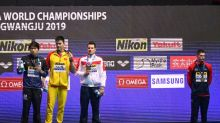 Dressel drives on but Sun doping spats overshadow worlds