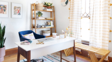 No home office? Set up shop in a closet, under the stairs, or on an ironing board. Seriously.