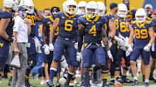 West Virginia football suspends 11 players for violating team rules