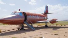 Elvis Presley's private jet is up for auction - red velvet seats and all
