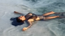 Salma Hayek stuns in sexy bathing suit as she floats in the ocean: 'Looks like heaven'