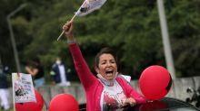 Hundreds join unions' car caravan protest in Bogota