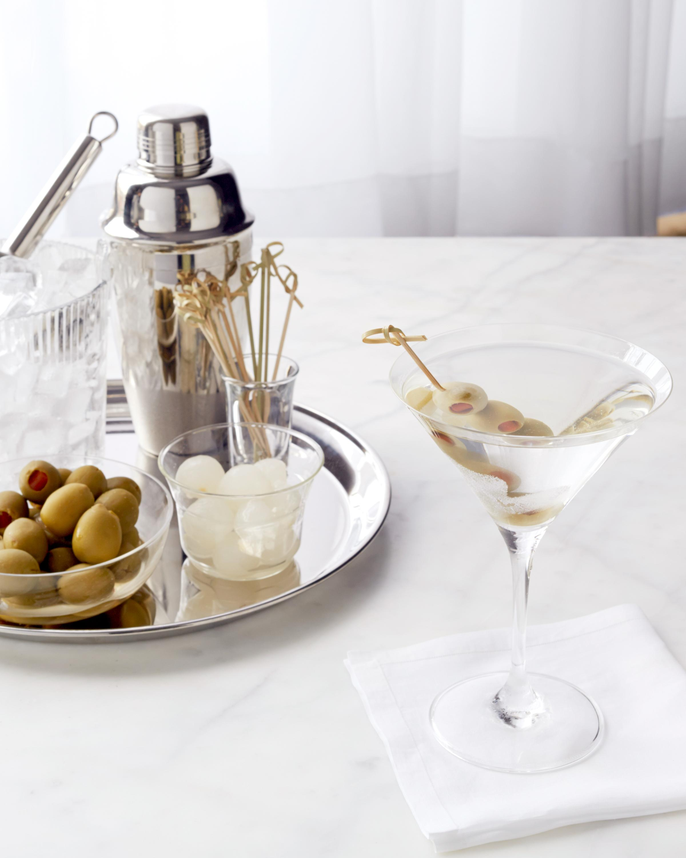 """<p>The art of the <a href=""""https://www.marthastewart.com/2226424/classic-cocktail-recipes"""" rel=""""nofollow noopener"""" target=""""_blank"""" data-ylk=""""slk:classic cocktail"""" class=""""link rapid-noclick-resp"""">classic cocktail</a> is as fresh as it ever was. For the time-pressed, intimidated, or minimalist drinkers out there, we bring you inspiration and reassurance, and some very good libations. Have you noticed that the most storied mixed drinks, like the <a href=""""https://www.marthastewart.com/865776/classic-martinis"""" rel=""""nofollow noopener"""" target=""""_blank"""" data-ylk=""""slk:martini"""" class=""""link rapid-noclick-resp"""">martini</a> pictured here, feature the alchemy of just two-to-three ingredients (we're not counting <a href=""""https://www.marthastewart.com/1507294/glorious-cocktail-garnishes"""" rel=""""nofollow noopener"""" target=""""_blank"""" data-ylk=""""slk:garnishes"""" class=""""link rapid-noclick-resp"""">garnishes</a>)? You don't have to have <a href=""""https://www.marthastewart.com/7615604/how-store-liquor-spirits"""" rel=""""nofollow noopener"""" target=""""_blank"""" data-ylk=""""slk:an arsenal on your liquor tray"""" class=""""link rapid-noclick-resp"""">an arsenal on your liquor tray</a> (or in the kitchen cupboard) to mix them. Unless you'd like to try them all in turn, of course.</p> <p>Some rely on fizz: Think of the irreproachable summer sundowner that is the gin and tonic. The wayward <a href=""""https://www.marthastewart.com/1008078/pimms-cup"""" rel=""""nofollow noopener"""" target=""""_blank"""" data-ylk=""""slk:Pimm's Cup"""" class=""""link rapid-noclick-resp"""">Pimm's Cup</a>, companion to <a href=""""https://www.marthastewart.com/7837458/marthas-favorite-summer-cocktail-hour-recipes"""" rel=""""nofollow noopener"""" target=""""_blank"""" data-ylk=""""slk:poolside parties"""" class=""""link rapid-noclick-resp"""">poolside parties</a>, and the <a href=""""https://www.marthastewart.com/1165549/moscow-mule"""" rel=""""nofollow noopener"""" target=""""_blank"""" data-ylk=""""slk:Moscow Mule"""" class=""""link rapid-noclick-resp"""">Moscow Mule</a>, gingery and cold in a copper cup. Or the elegant <a href=""""htt"""