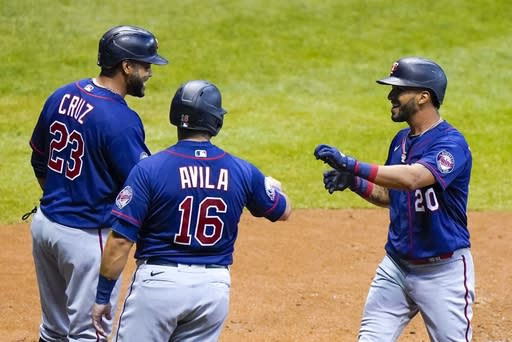 Minnesota Twins' Eddie Rosario celebrates his grand slam with Alex Avila (16) and Nelson Cruz (23) during the third inning of a baseball game against the Milwaukee Brewers Monday, Aug. 10, 2020, in Milwaukee. (AP Photo/Morry Gash)