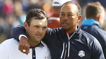 Woods makes winning move with Reed pick