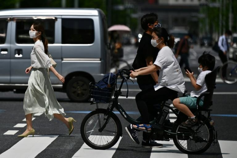 Japan is under a nationwide state of emergency but appears to have avoided the large-scale coronavirus outbreaks seen in parts of the world (AFP Photo/Charly TRIBALLEAU)