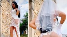 Influencer flashes G-string in completely sheer wedding dress