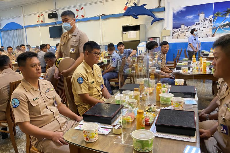 Taiwan navy sailors sit with partitions on the dining tables, part of coronavirus (COVID-19) pandemic prevention measures, before Taiwan's President Tsai Ing-wen arrives for lunch with them, at the Zuoying naval base in Kaohsiung, Taiwan