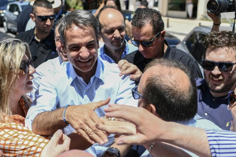 Greece's opposition New Democracy leader Kyriakos Mitsotakis was warmly received during a recent visit to Almyros in central Greece (AFP Photo/ARIS MESSINIS)