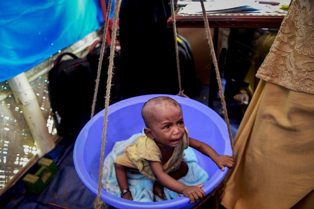 The UN Children's Fund, UNICEF, has estimates that 25,000 children in the overcrowded Rohingya camps are suffering from severe malnutrition (AFP Photo/Munir UZ ZAMAN)