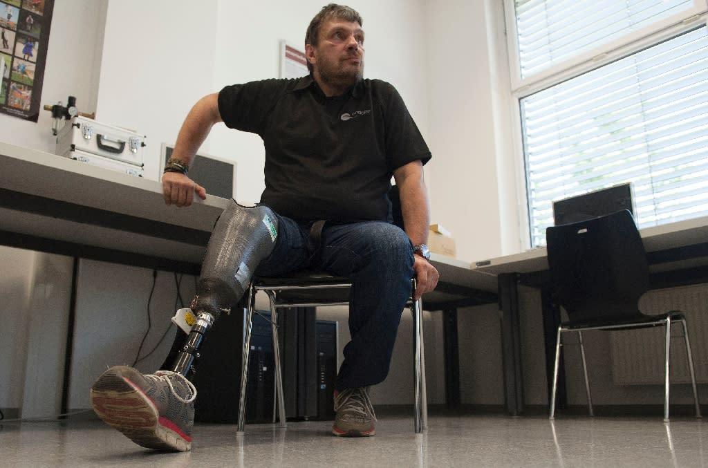 Wolfgang Rangger, a patient of professor Hubert Egger of Linz University poses with his 'feeling' leg prosthesis' on June 8, 2015 in Linz (AFP Photo/Samuel Kubani)