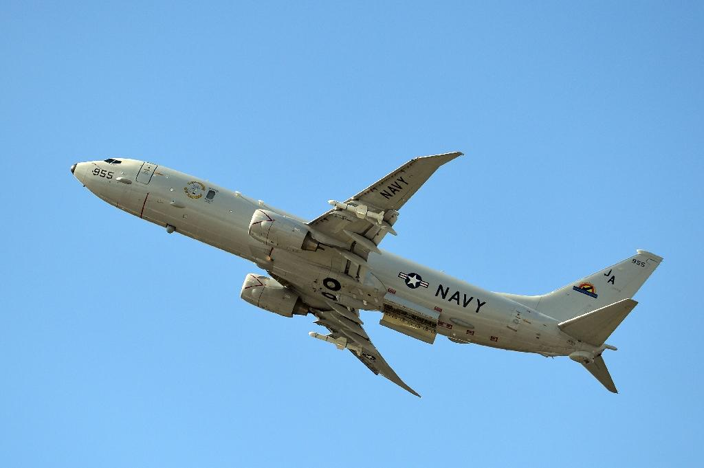 The US Navy's P-8 Poseidon surveillance plane received several warnings from the Chinese military as it flew over the South China Sea (AFP Photo/Carl Court)