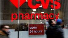 CVS profit miss, rebate questions send shares tumbling eight percent