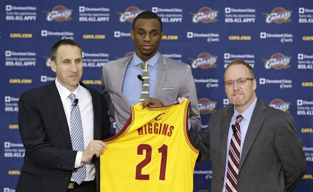 Cleveland Cavaliers head coach David Blatt, left to right, Andrew Wiggins and general manager David Griffin hold up Wiggins jersey during a new conference Friday, June 27, 2014, in Independence, Ohio
