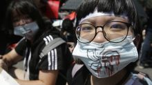 The Latest: Taiwan groups rally to support Hong Kong protest