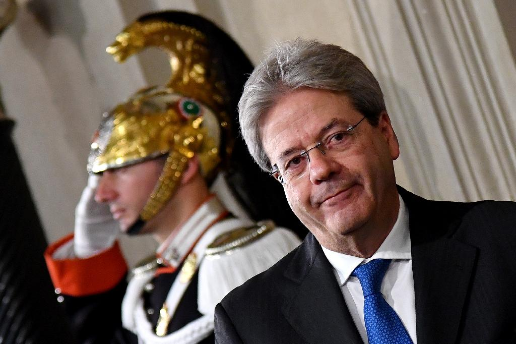 Paolo Gentiloni, Italy's new prime minister, arrives for a press conference in Rome on December 11, 2016 (AFP Photo/Alberto PIZZOLI)