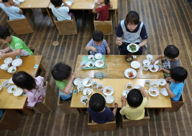 School lunches in Japan are mandatory -- no packed lunches allowed -- and while they are not free for most, they are heavily subsidised (AFP Photo/KAZUHIRO NOGI)