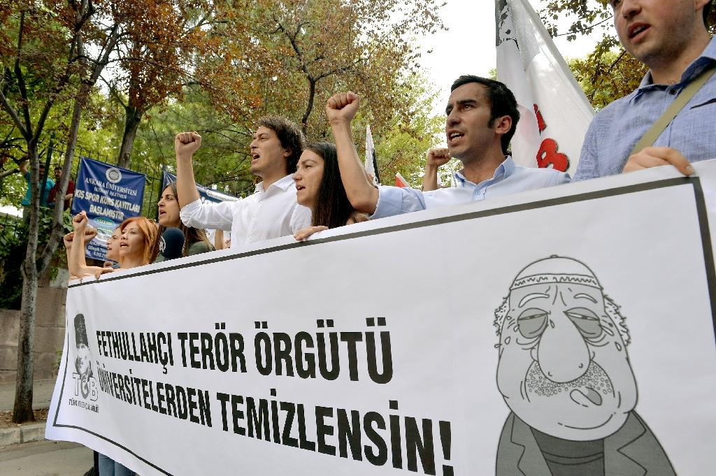 Pro-nationalist university students shout during a protest against U.S.-based cleric Fethullah Gulen and his followers during a demonstration in Ankara, on July 21, 2016