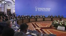 Foreign powers back Syria truce deal, war erupts among rebels