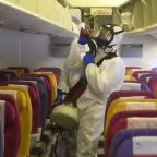 Thai airline staff disinfect plane to stop the spread of coronavirus