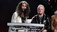 Joey Kramer awkwardly, briefly reunites with feuding Aerosmith bandmates at MusiCares gala